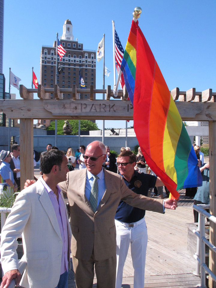 Photo - Rich Helfant, left, president of the Greater Atlantic City LGBT Alliance, speaks with Atlantic City, N.J. Mayor Don Guardian, center, and former city councilman and longtime gay activist John Schultz, right, on the Atlantic City boardwalk, Monday, June 16, 2014. Atlantic City is planning a series of events to attract gay tourists, who are becoming an increasingly important part of the resort's growth strategy. (AP Photo/Wayne Parry)
