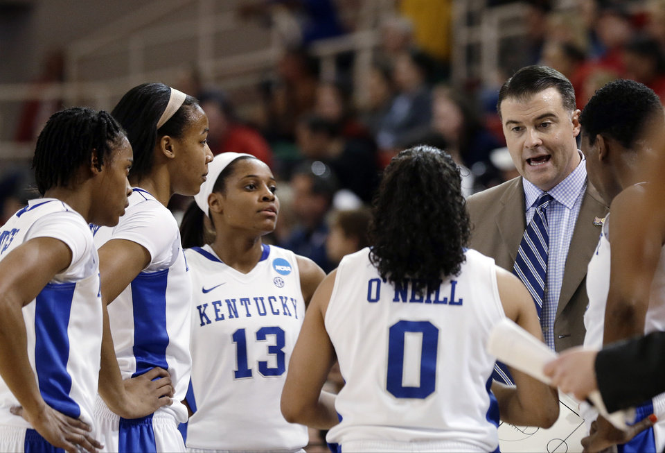 Photo - Kentucky coach Matthew Mitchell talks to his team in the first half of a second-round game against Dayton in the NCAA women's college basketball tournament Tuesday, March 26, 2013, in New York. (AP Photo/Frank Franklin)