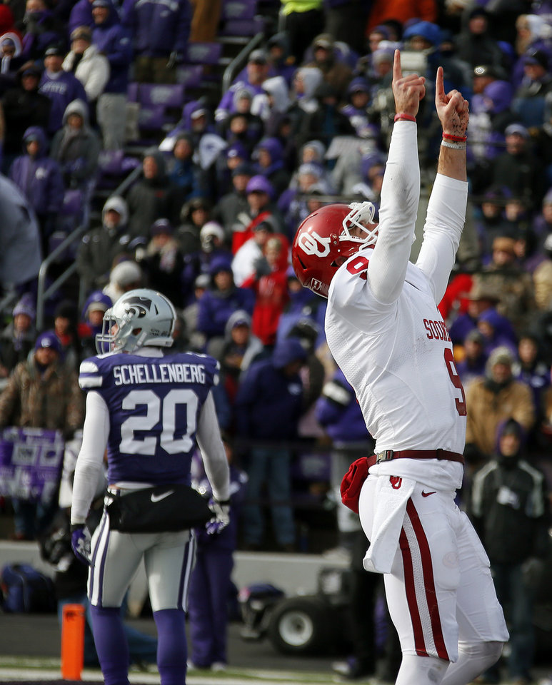 Oklahoma's Trevor Knight (9) celebrates after scoring a touchdown during an NCAA college football game between the Oklahoma Sooners and the Kansas State University Wildcats at Bill Snyder Family Stadium in Manhattan, Kan., Saturday, Nov. 23, 2013. Oklahoma won 41-31. Photo by Bryan Terry, The Oklahoman