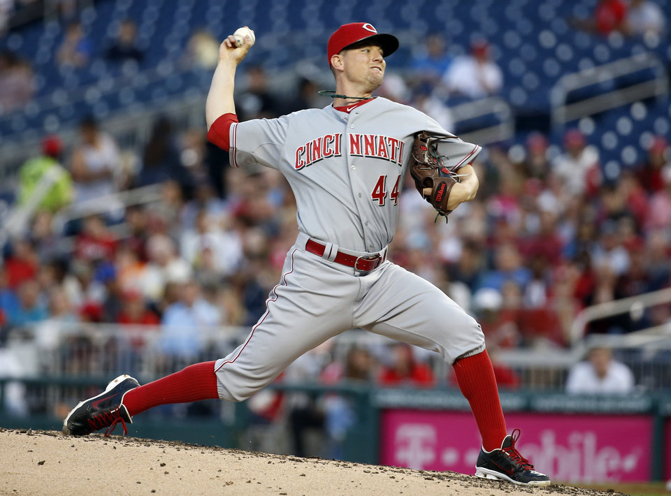 Photo - Cincinnati Reds starting pitcher Mike Leake (44) throws during the third inning of a baseball game against the Washington Nationals at Nationals Park Monday, May 19, 2014, in Washington. (AP Photo/Alex Brandon)