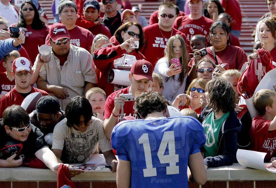 Photo - OU's Sam Bradford signs autographs after Oklahoma's Red-White football game at The Gaylord Family - Oklahoma Memorial Stadiumin Norman, Okla., Saturday, April 11, 2009. Photo by Bryan Terry, The Oklahoman