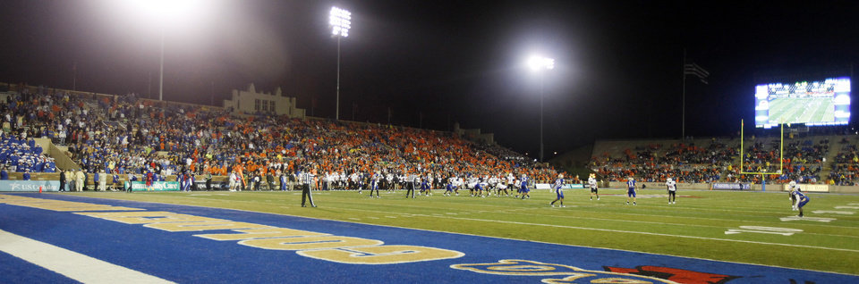 Photo - A large number of fans stayed to watch the college football game between the Oklahoma State University Cowboys  and the University of Tulsa Golden Hurricane after post-midnight start because of severe weather at H.A. Chapman Stadium in Tulsa, Okla., Sunday morning, Sept. 18, 2011. Photo by Nate Billings, The Oklahoman