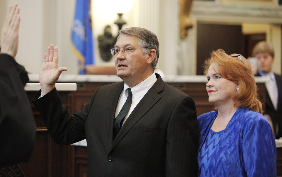 Curtis McDaniel, of Smithville, is sworn in by Chief Justice Steven Taylor as  a member of the House of Representatives while his wife Debbie looks on in the House chamber at the state Capitol in Oklahoma City Wednesday, Feb. 22, 2012. Photo by Paul B. Southerland, The Oklahoman