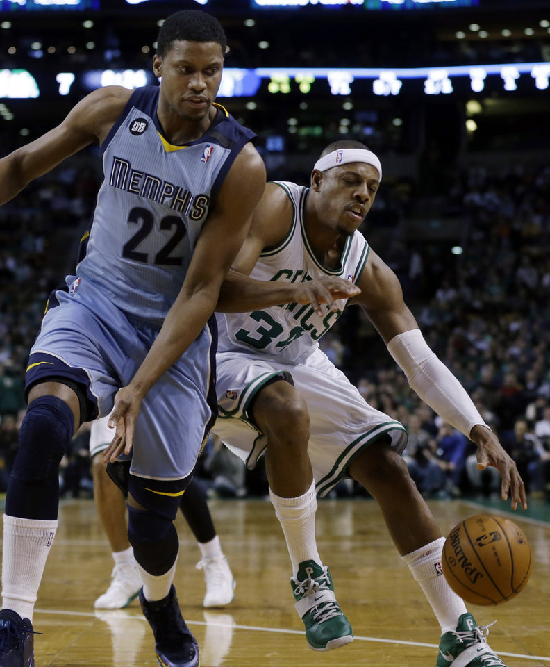 Boston Celtics small forward Paul Pierce (34) makes contact with Memphis Grizzlies small forward Rudy Gay (22) while driving during the first quarter of an NBA basketball game in Boston, Wednesday, Jan. 2, 2013. (AP Photo/Elise Amendola)