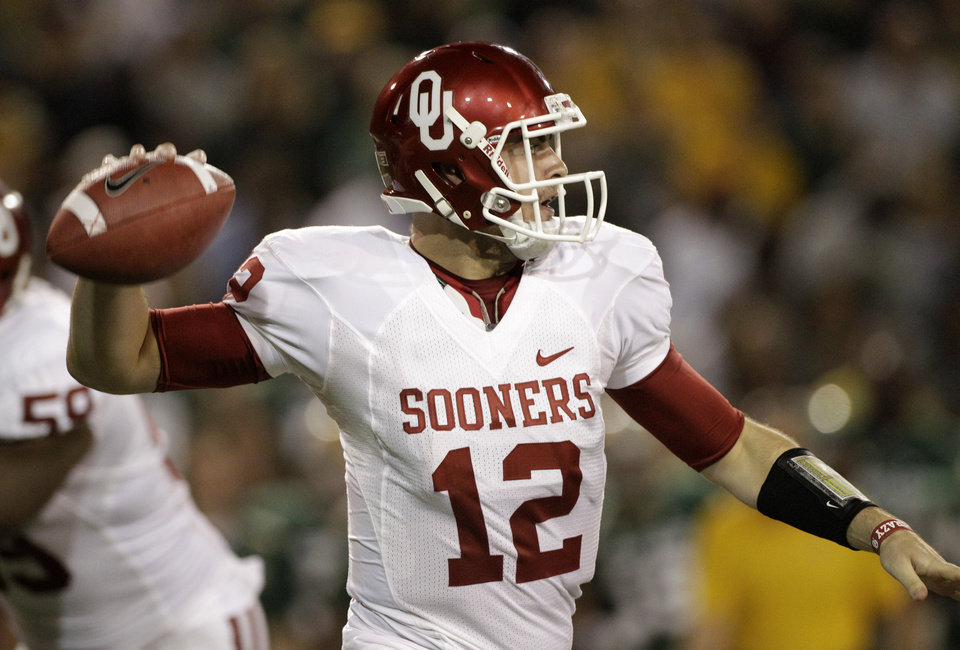 Oklahoma quarterback Landry Jones (12) prepares to pass in the first half of an NCAA college football game against Baylor Saturday, Nov. 19, 2011, in Waco, Texas. (AP Photo/Tony Gutierrez)