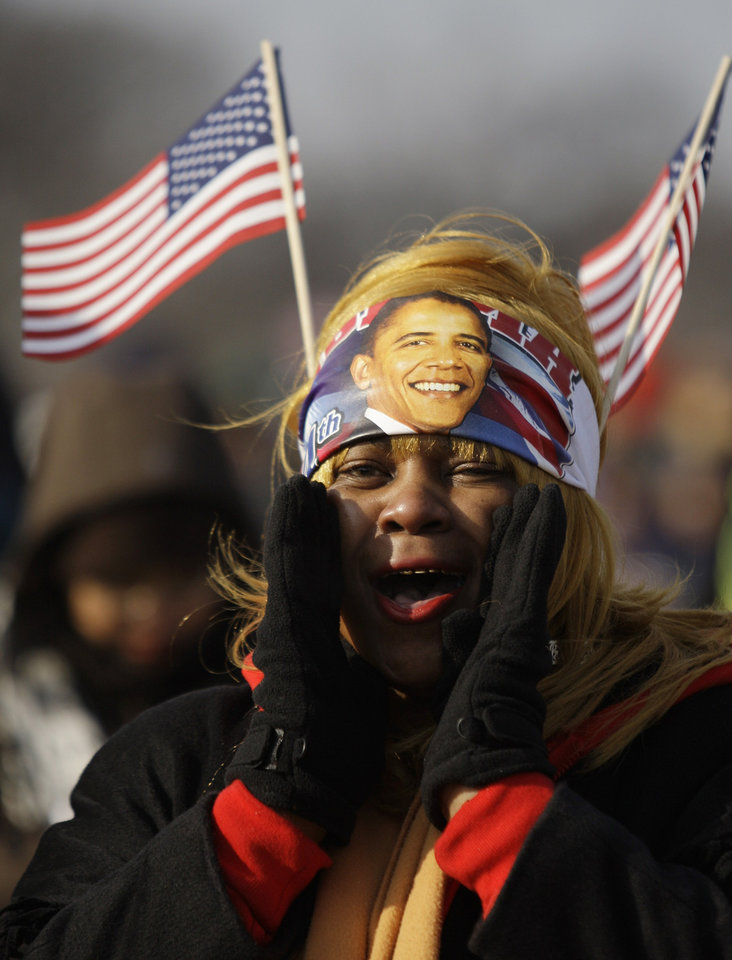 Photo - Shaine Martin of New Orleans, La., cheers as she waits on National Mall for the inauguration of  President-elect Barack Obama in Washington, Tuesday, Jan. 20, 2009. (AP Photo/Carolyn Kaster)