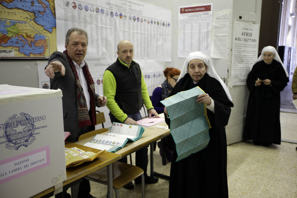 A nun votes in a polling station in downtown Rome, Sunday, Feb. 24, 2013. Italy votes in a watershed parliamentary election Sunday and Monday that could shape the future of one of Europe's biggest economies. (AP Photo/Andrew Medichini)