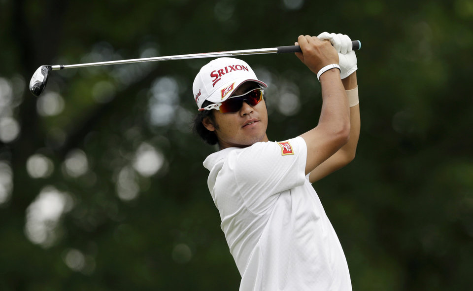 Photo - Hideki Matsuyama, of Japan, watches his tee shot on the ninth hole during the third round of the PGA Colonial golf tournament in Fort Worth, Texas, Saturday, May 24, 2014.   (AP Photo/LM Otero)