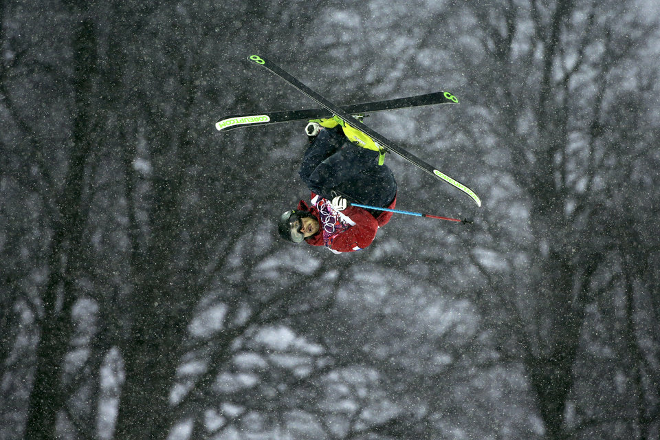 Photo - France's Kevin Rolland competes during the men's freestyle skiing halfpipe qualification at the Rosa Khutor Extreme Park, at the 2014 Winter Olympics, Tuesday, Feb. 18, 2014, in Krasnaya Polyana, Russia. (AP Photo/Jae C. Hong)