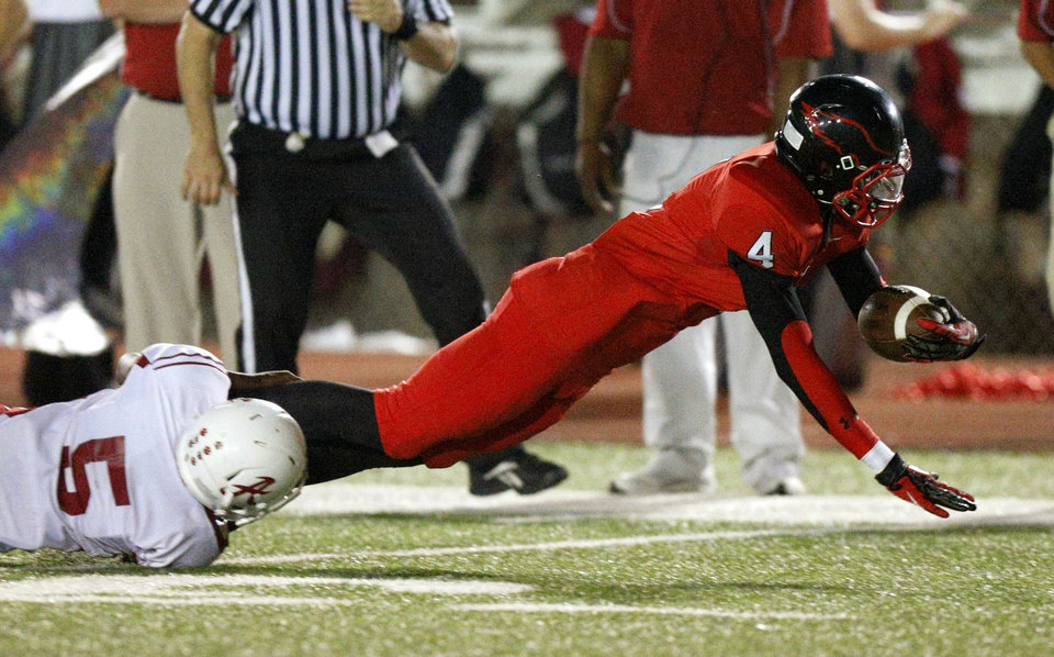 Del City\'s Michael Johnson is brought down by Ardmore\'s Andrew Clark during a high school football game in Del City, Okla., Friday, September 28, 2012. Photo by Bryan Terry, The Oklahoman
