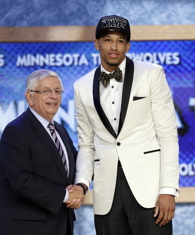 Photo - NBA Commissioner David Stern, left, shakes hands with Colorado's Andre Roberson, who was selected by the Minnesota Timberwolves in the first round of the NBA basketball draft, Thursday, June 27, 2013, in New York. (AP Photo/Kathy Willens)