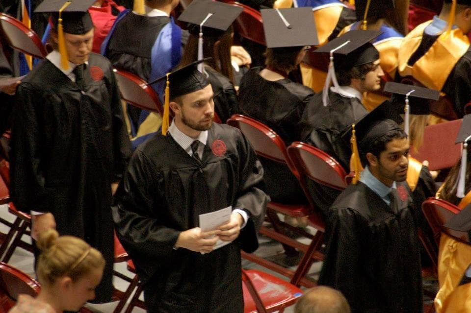 Photo - University of Oklahoma health and exercise science graduate Mitch Merckling walks to his seat during convocation. Merckling graduated in May with his bachelor's degree.  PHOTO PROVIDED