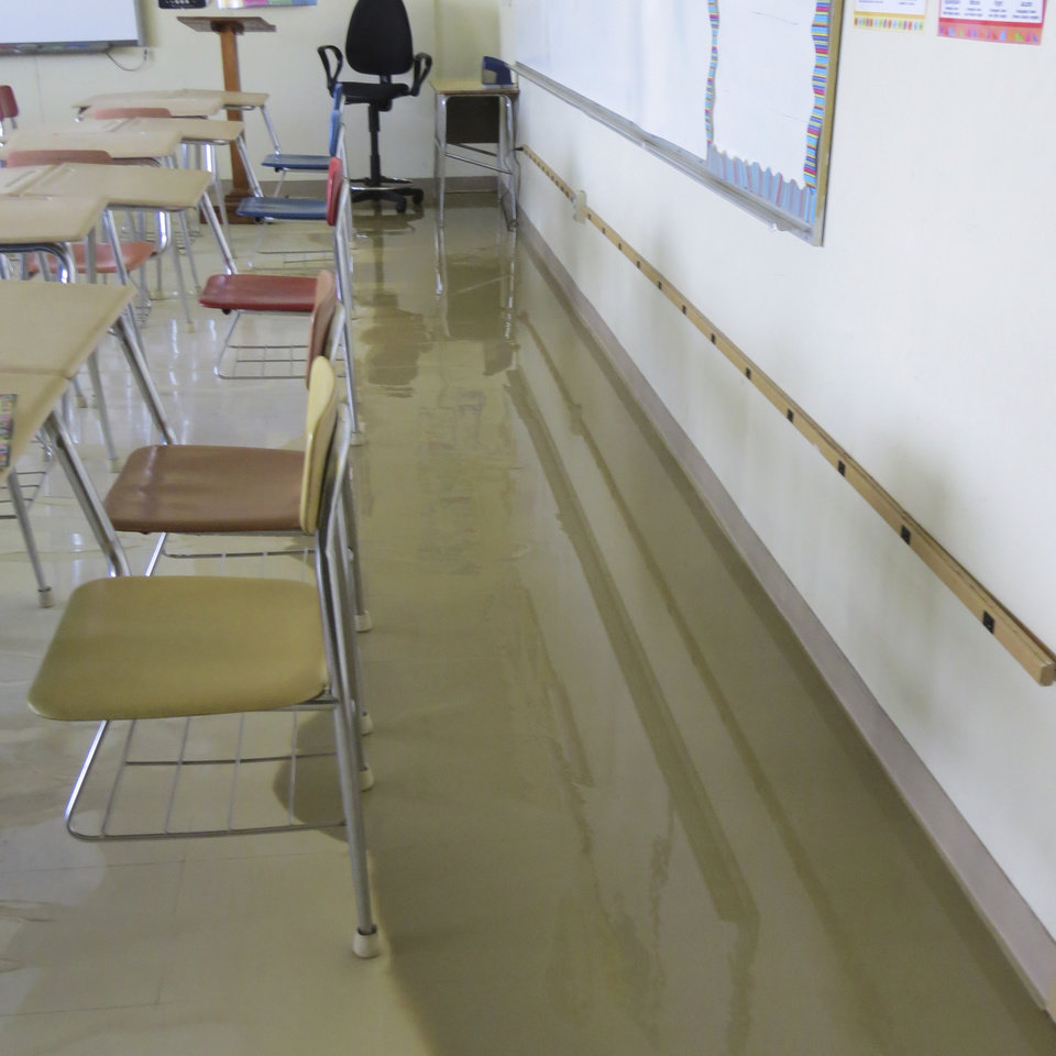 Photo -  Damage from an August 2013 water pipe break at Parker Intermediate School is the subject of a lawsuit between the Oklahoma Schools Risk Management Trust and McAlester Public Schools.    Provided  -  Provided