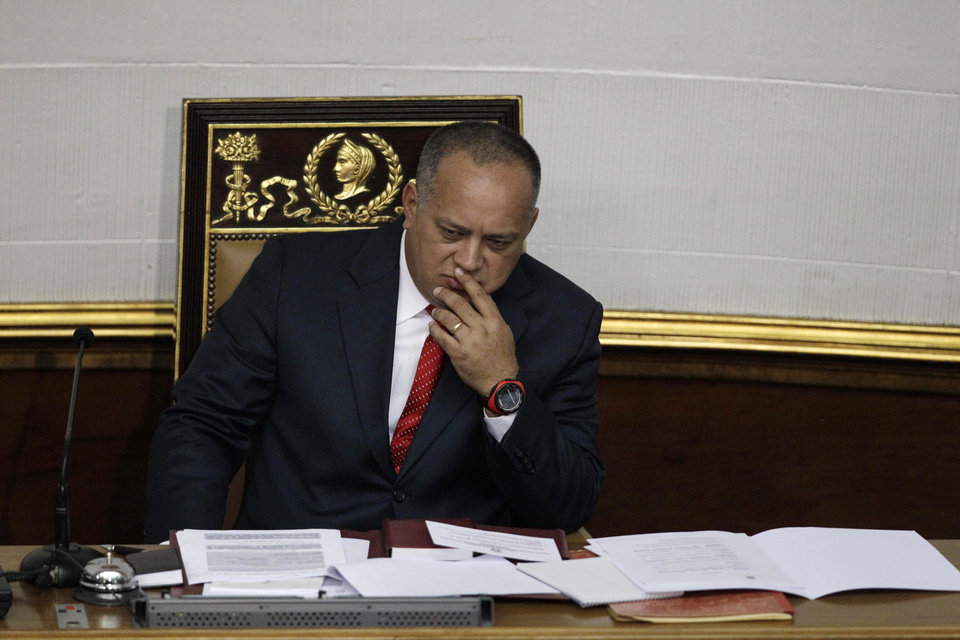 Photo - National Assembly President Diosdado Cabello gestures before addressing the National Assembly in Caracas, Venezuela, Saturday, Jan. 5, 2013. Allies of President Hugo Chavez on Saturday chose to keep Cabello as National Assembly president, who is the next in line to step in as a caretaker leader in some circumstances. Opposition leaders have argued that if Chavez doesn't make it back by Jan. 10 to Venezuela from Cuba where he underwent cancer surgery, the president of the National Assembly should take over as interim president.  If Chavez dies or is declared incapacitated, the constitution says that a new election should be called and held within 30 days. Cabello is a longtime Chavez ally who is widely considered to wield influence within the military. (AP Photo/Ariana Cubillos)