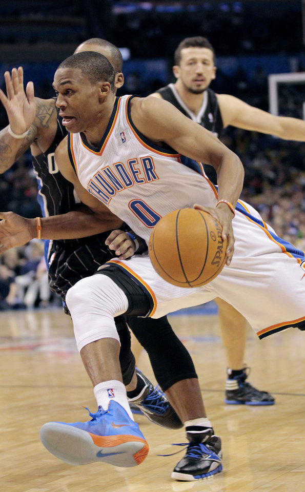 Oklahoma City Thunder's Russell Westbrook (0) drives to the basket in the second half as the Oklahoma City Thunder defeat the Orlando Magic 97-89 in NBA basketball at the Chesapeake Energy Arena on Sunday, Dec. 25, 2011, in Oklahoma City, Okla.  Photo by Steve Sisney, The Oklahoman