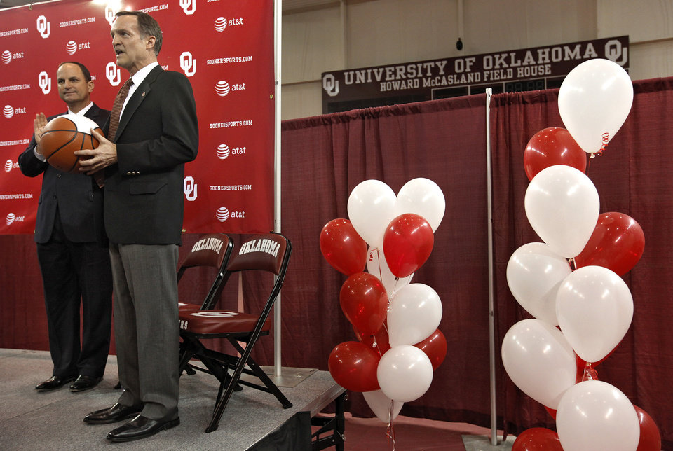 University of Oklahoma athletic director Joe Castiglione, left, looks on as new men's basketball coach Lon Kruger is introduced as the new University of Oklahoma men's basketball coach on Monday, April 4, 2011, in Norman, Okla.