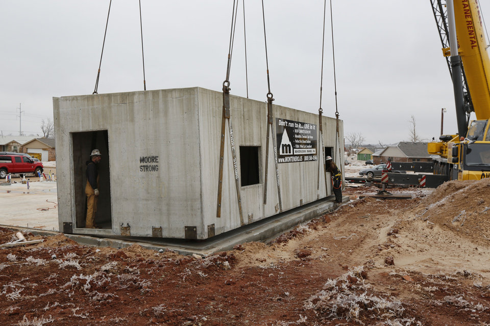 Photo - A monolithic safe space for a tornado-resistant house is installed at a job  site in Moore. Montenero U.S. of Jacksonville, Fla., manufactures the concrete structures.  Steve Gooch - The Oklahoman