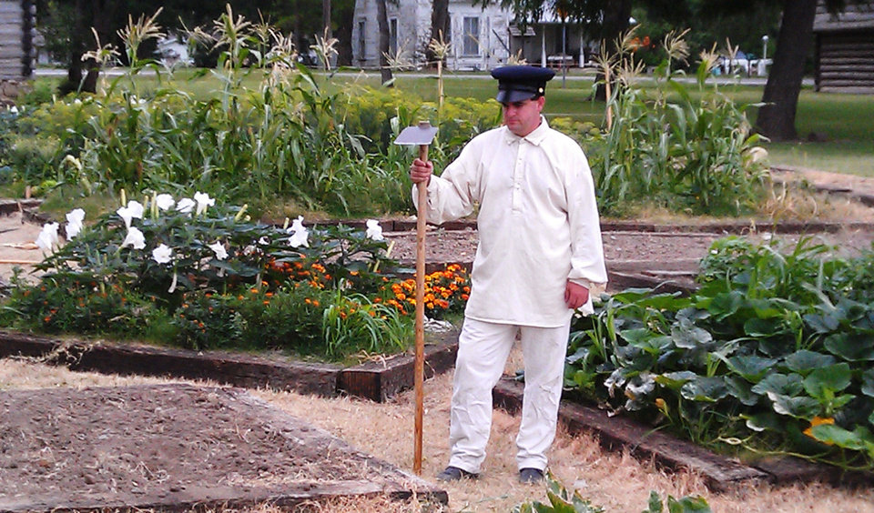 Photo - Correy Twilley, a historical interpreter at Fort Gibson Historic Site, works the new Arbuckle Heritage Garden, which depicts an intersection of Oklahoma's military and farming history in the 19th  century. PHOTO PROVIDED