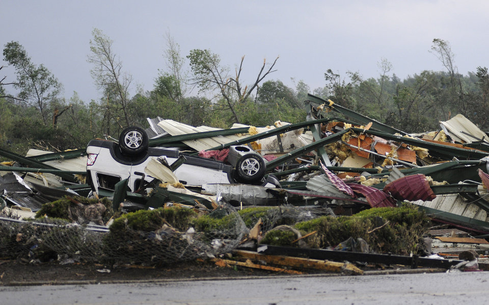 Photo - The remains of Hill's Carpet Center in Concord Ala., are seen after what appeared to be a tornado ripped through parts of the town late Wednesday, April 27, 2011. The damage in the area is extensive with homes and businesses destroyed and people injured.  (AP Photo/Birmingham News, Jeff Roberts)
