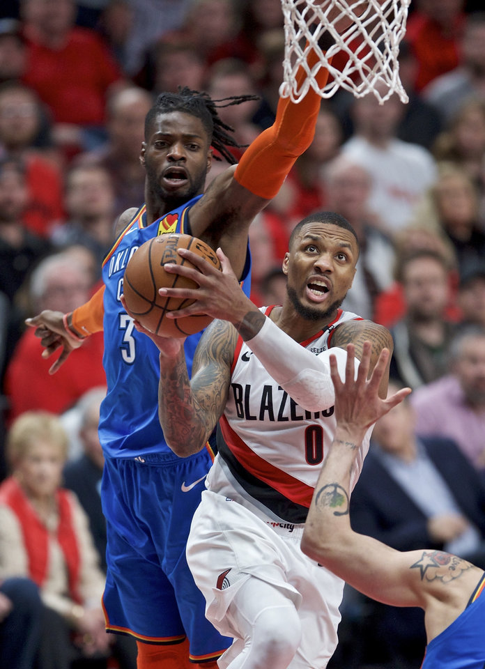 Photo - Portland Trail Blazers guard Damian Lillard, right, shoots in front of Oklahoma City Thunder forward Nerlens Noel during the second half of Game 2 of an NBA basketball first-round playoff series Tuesday, April 16, 2019, in Portland, Ore. (AP Photo/Craig Mitchelldyer)