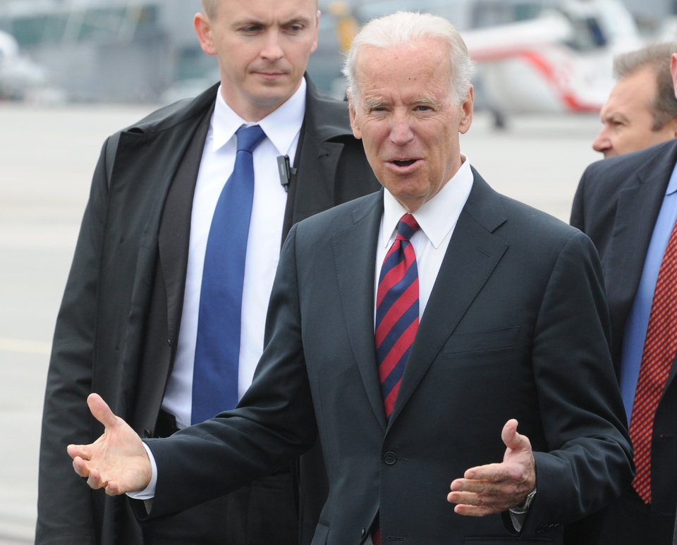 Photo - U.S. Vice President Joe Biden gestures as he arrives at the Okecie military airport in Warsaw, Poland, Tuesday, March 18, 2014. Biden arrived in Warsaw for consultations with Polish Prime Minister Donald Tusk and President Bronislaw Komorowski, a few hours after Russian President Vladimir Putin approved a draft bill for the annexation of Crimea, one of a flurry of steps to formally take over the Black Sea peninsula. (AP Photo/Alik Keplicz)