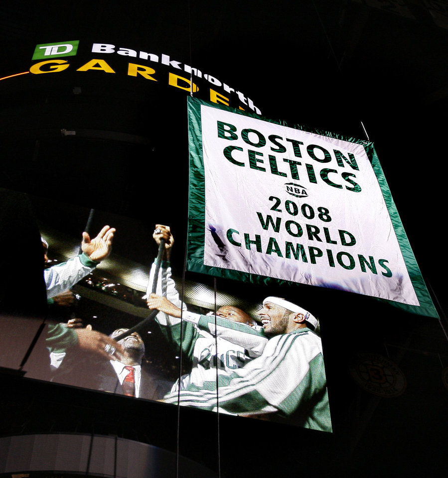 Photo - Boston Celtics are seen on a television screen as they raise the Celtics' 17th NBA championship banner during ceremonies before an NBA basketball game against the Cleveland Cavaliers in Boston on Tuesday, Oct. 28, 2008. (AP Photo/Winslow Townson) ORG XMIT: MAEA112