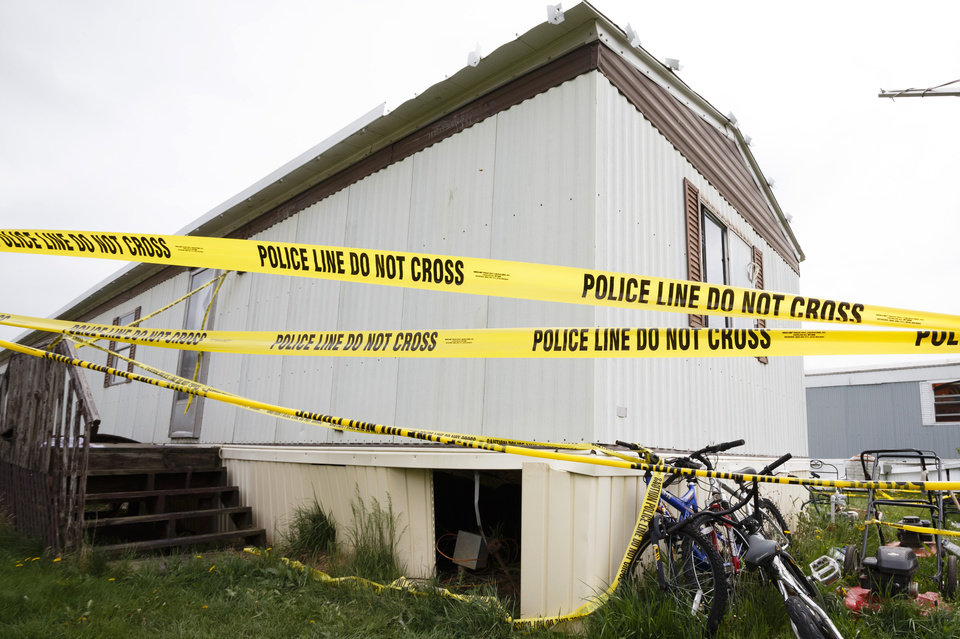 Police tape closes off the home of Blake and Blaine Romes in Ottawa, Ohio, Friday, May 10, 2013. Two teenage brothers who had been reported missing were found dead after a third teen pointed authorities to their bodies before he was taken into custody, officials said. The three teens, 14-year-old Blaine Romes, 17-year-old Blake Romes and 17-year-old Michael Fay, lived together with their mothers inside a trailer home in Ottawa in northwest Ohio, neighbors said. The three had been the subject of an Amber Alert issued Thursday morning after a relative returned to the home and found a crime scene, the Putnam County Sheriff's Office said. Fay was taken into custody Thursday afternoon.  (AP Photo/Rick Osentoski)