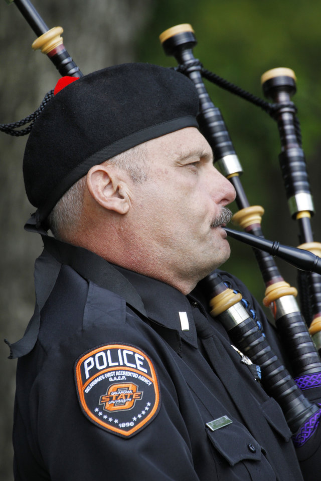 Lt. Curtis Burns, Oklahoma State University Police Department plays the bagpipes during the Oklahoma Law Enforcement Officers Memorial Service in Oklahoma City , Friday May 10, 2013. Photo By Steve Gooch, The Oklahoman
