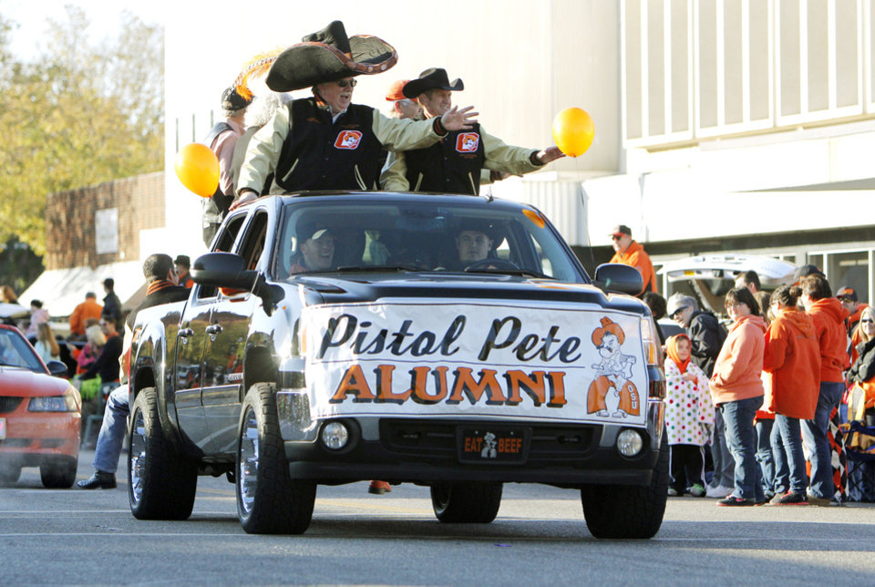 Photo - Pistol Pete alumni wave to fans during the Oklahoma State Cowboy's homecoming parade in downtown Stillwater, OK, Saturday, Oct. 29, 2011. By Paul Hellstern, The Oklahoman