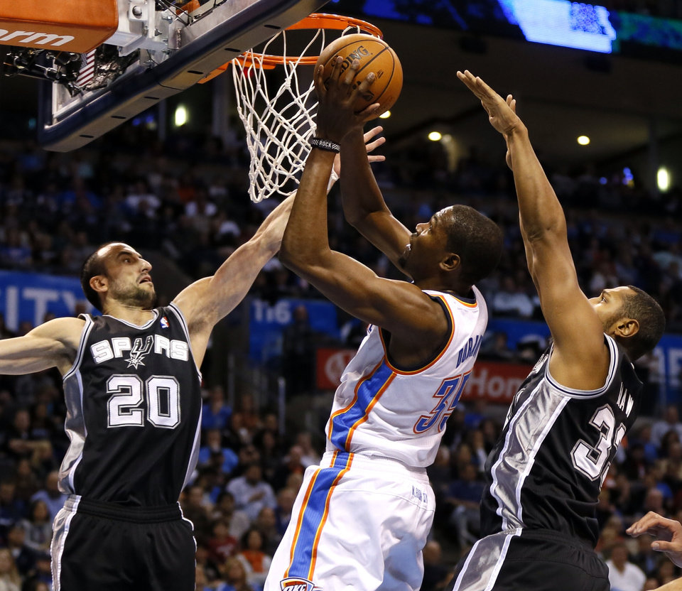 Oklahoma City's Kevin Durant shoots between San Antonio's Manu Ginobili, left,  and Boris Diaw during an NBA basketball game between the Oklahoma City Thunder and the San Antonio Spurs at Chesapeake Energy Arena in Oklahoma City, Wednesday, Nov. 27, 2013. Photo by Nate Billings, The Oklahoman