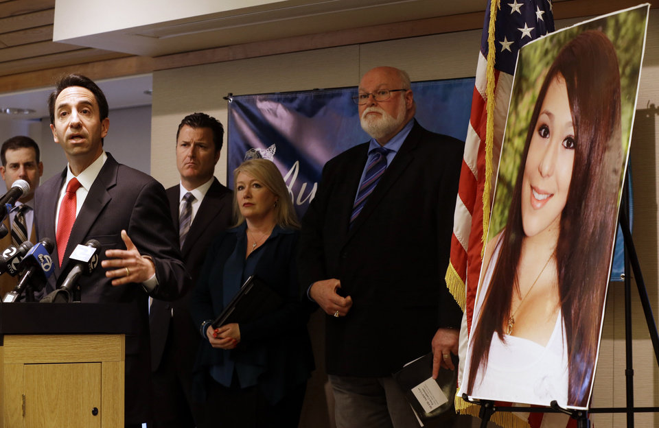 Photo - From left, Santa Clara County District Attorney Jeff Rosen talks about the provisions of Audrie's Law as Attorney Robert Allard, Sheila Pott, mother of Audrie Pott, and State Sen. Jim Beall, D-San Jose, listen in on Friday, March 7, 2014, in Saratoga, Calif. Audrie's Law is a legislative proposal aimed at deterring the bullying, cyberbullying, and sexual assault that played roles in the suicide of Audrie Pott, a 15-year-old Saratoga High School student. (AP Photo/Marcio Jose Sanchez)