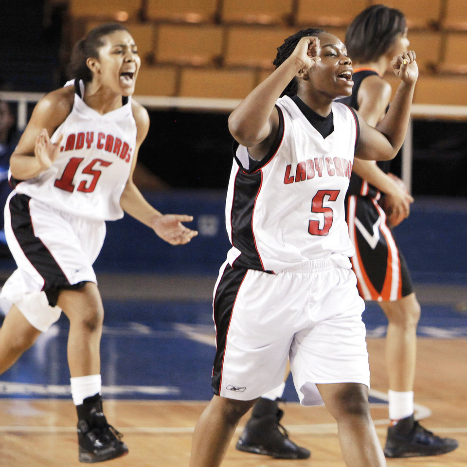 Ashlee Pitts, left, and Ashlie Baker react after Tulsa East Central's win Friday. Photo by Nate Billings, The Oklahoman