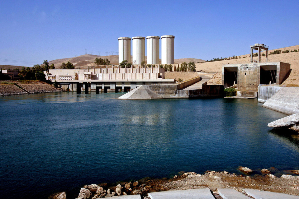 Photo - FILE - This Oct. 31, 2007 file photo, shows a general view of the dam in Mosul, 360 kilometers (225 miles) northwest of Baghdad, Iraq. The rapid advance of the Islamic State group, which captured Iraq's second largest city of Mosul and declared a self-styled Islamic Caliphate straddling the Iraq-Syria border, has plunged Iraq into its worst crisis since U.S. troops withdrew in 2011. Experts say the strategy for capturing the dams is twofold. First, seizing dams and large reservoirs can be used as a military tactic. Flooding the terrain slows any possible encounters with military tanks and foot soldiers, giving the militants freedom of movement, if briefly. (AP Photo/ Khalid Mohammed, File)