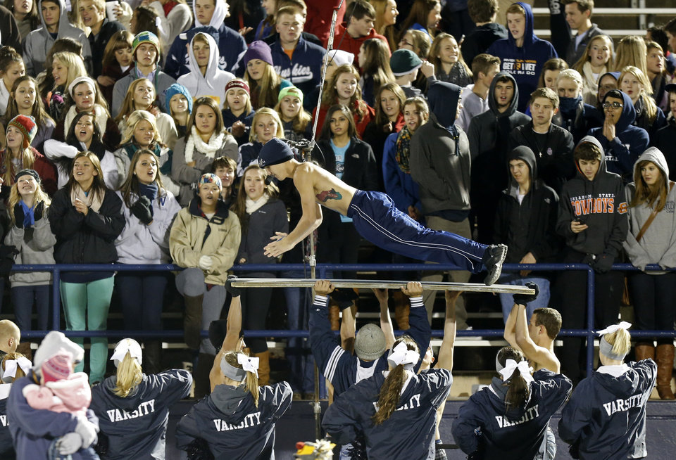 Photo - An Edmond North student does push-ups after a touchdown in a high school football game between Edmond North and Midwest City at Wantland Stadium in Edmond, Thursday, October 25, 2012. Photo by Bryan Terry, The Oklahoman