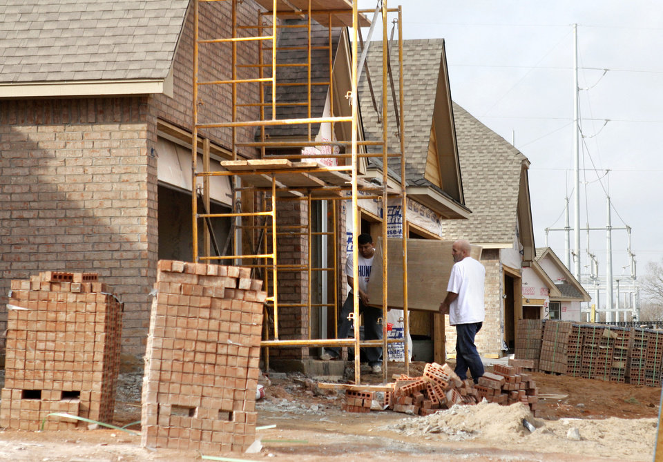 Photo - Construction is ongoing in Edmond's Hampden Hallow neighborhood. Edmond issued 603 building permits last year, up from 386 permits in 2011.