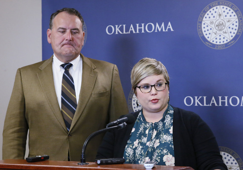 Photo - Senate Democratic leader John Sparks, D-Norman, left, and state Rep. Emily Virgin, D-Norman, right, talk with the media at the state Capitol concerning Gov. Mary Fallin and Republican legislative leaders' announcement of a deal to shore up the state budget in Oklahoma City, Monday, Oct. 23, 2017. Virgin and Sparks said there are not enough votes to pass the plan. (AP Photo/Sue Ogrocki)