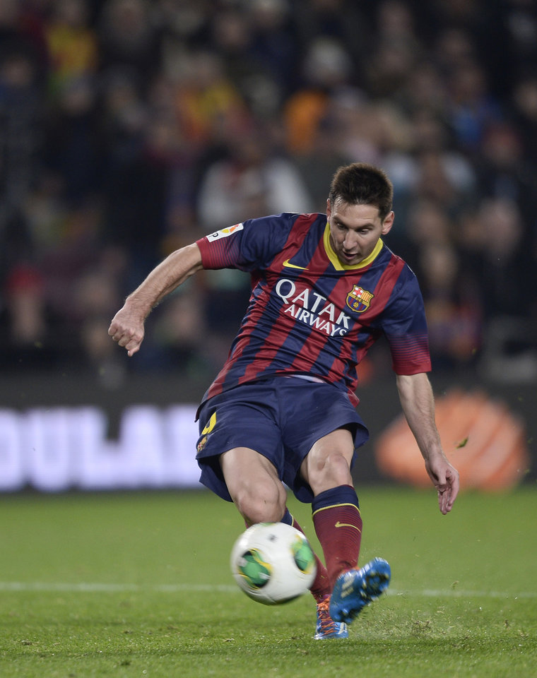 Photo - FC Barcelona's Lionel Messi, from Argentina,  kicks the ball to score against Getafe during a Copa del Rey soccer match at the Camp Nou stadium in Barcelona, Spain, Wednesday, Jan. 8, 2014. (AP Photo/Manu Fernandez)