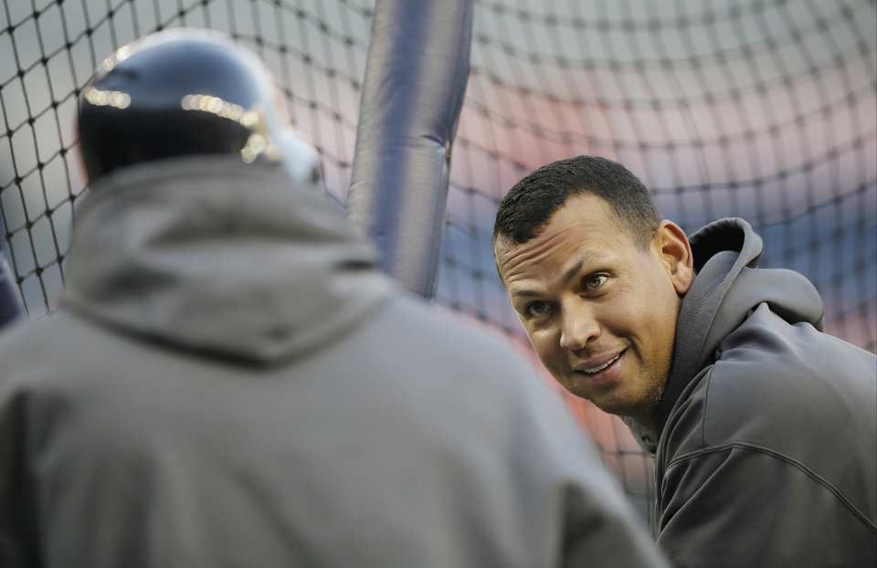 New York Yankees' Alex Rodriguez, right, talks to teammate Raul Ibanez during batting practice before Game 1 of the American League championship series against the Detroit Tigers on Saturday, Oct. 13, 2012, in New York. (AP Photo/Matt Slocum)