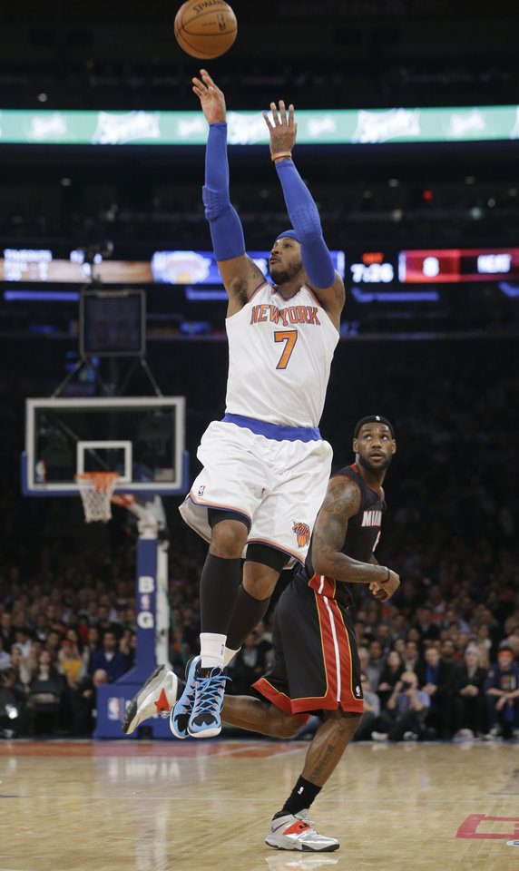 Photo - New York Knicks' Carmelo Anthony (7) gets past Miami Heat's LeBron James to shoot during the first half of an NBA basketball game on Thursday, Jan. 9, 2014, in New York. (AP Photo/Frank Franklin II)