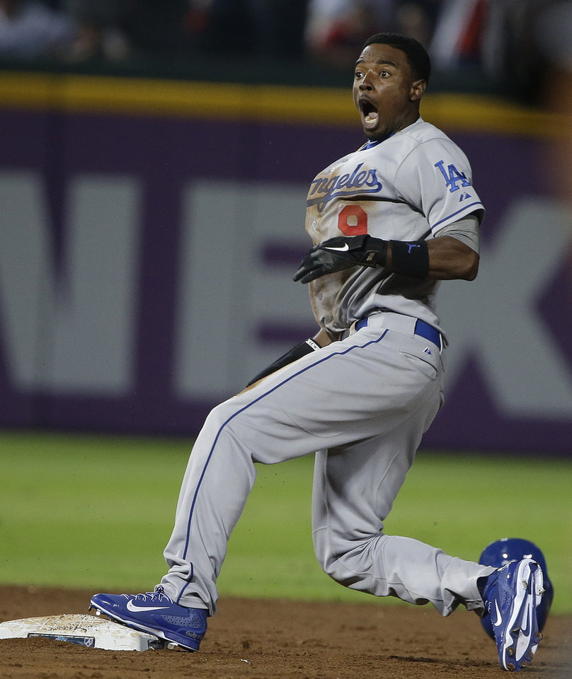 Photo - Los Angeles Dodgers' Dee Gordon reacts to being called out after Atlanta Braves shortstop Andrelton Simmons made the tag on his steal-attempt in the ninth inning of Game 2 of the National League division series on Friday, Oct. 4, 2013, in Atlanta. (AP Photo/John Bazemore)