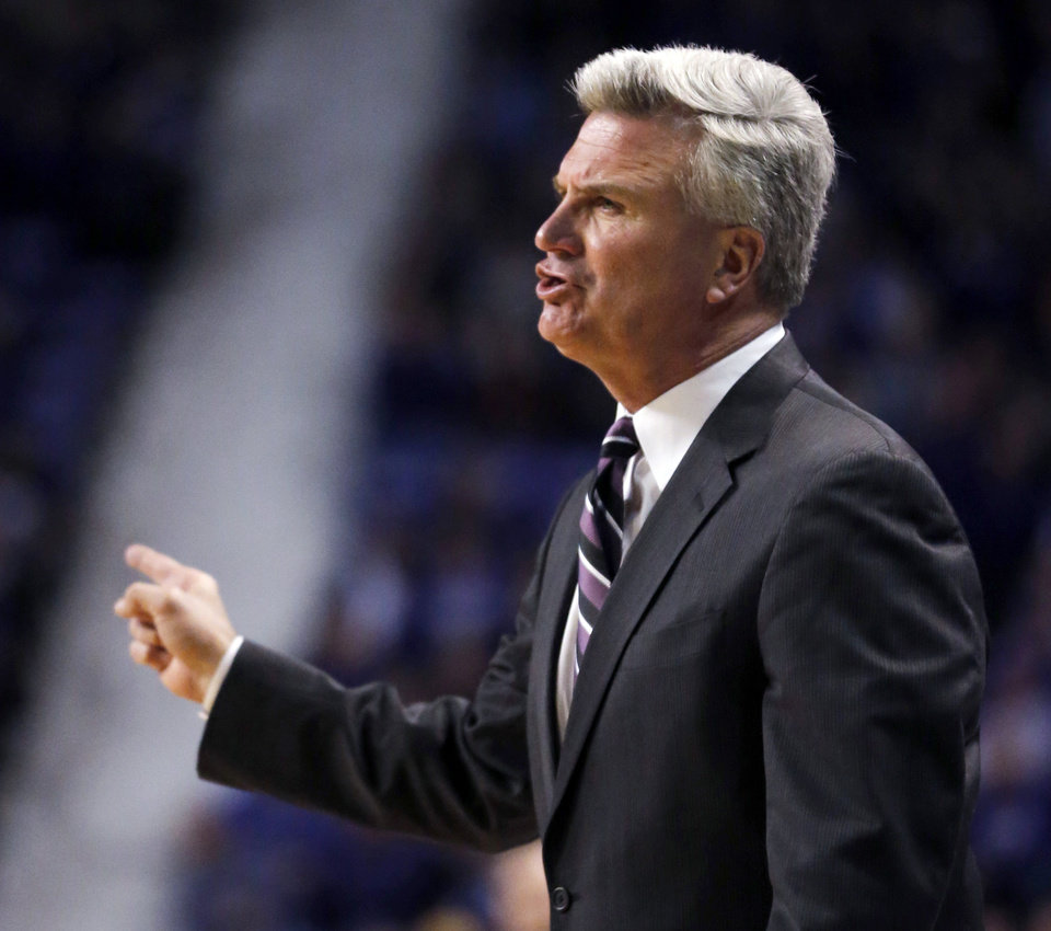 Photo - Kansas State head coach Bruce Weber directs his team during the first half of an NCAA college basketball game against West Virginia in Manhattan, Kan., Monday, Feb. 18, 2013. (AP Photo/Orlin Wagner)