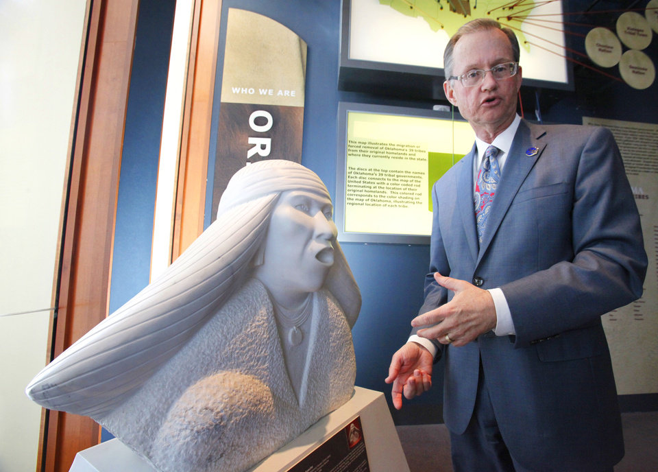 Photo - Bob Blackburn, executive director of the Oklahoma Historical Society, is shown next to the sculpture by Allan Houser titled