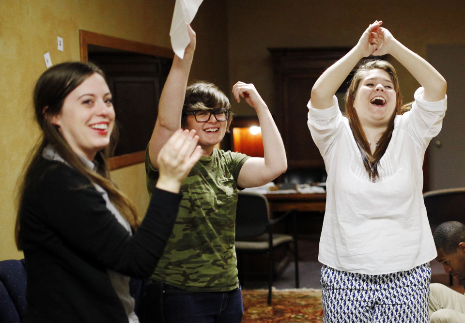 Photo - NewsOK interns (left-right) Catherine Sweeney, Paighten Harkins and Jessica Allison celebrate victory at Escape OKC on July 11, 2014 in Oklahoma City. Photo by KT King, The Oklahoman