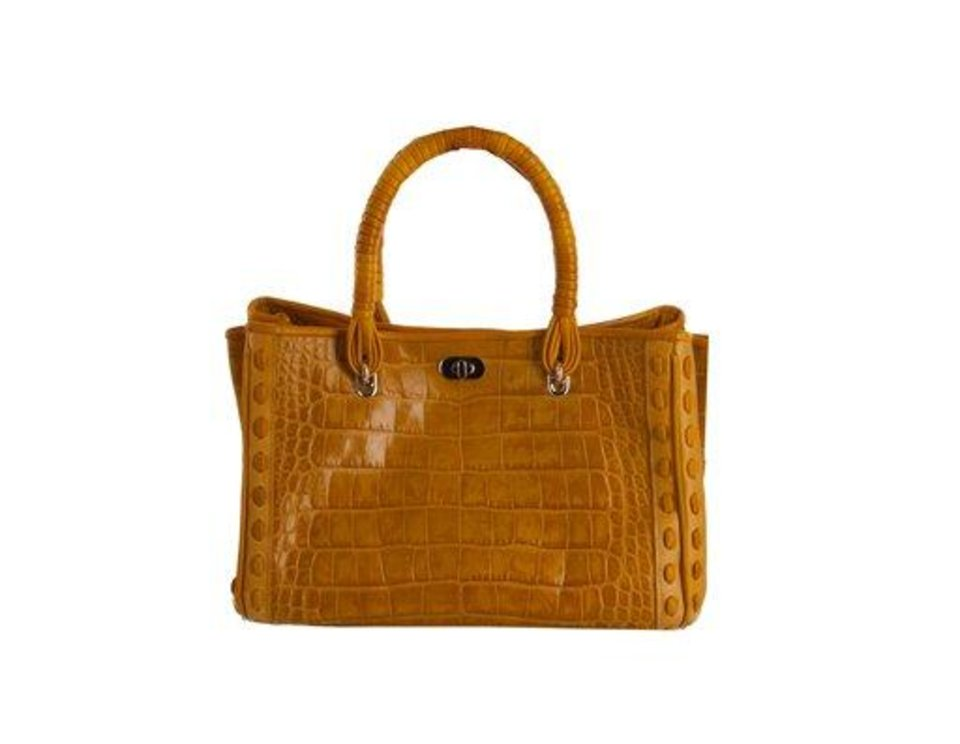 Photo - In this undated image released by Elie Tahari, a burnt orange handled bag made of croc embossed leather is shown. Exotic skins _ and many more faux exotic skins _ can bridge the gap between too much and not enough. Choices go from neon embossed leathers that mimic python and ostrich to rare and very expensive tree-frog skin. It's mostly accessories, but there are a lot of skin-inspired printed fabrics out there, too. (AP Photo/Elie Tahari)