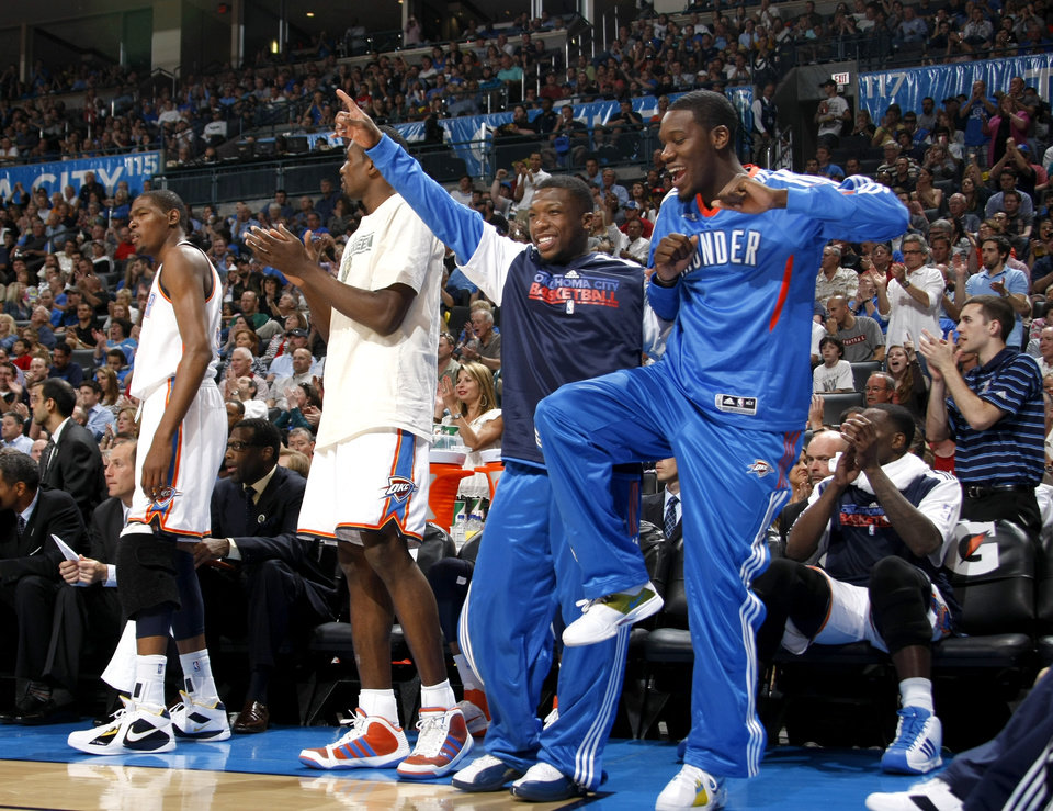 Photo - From left, Oklahoma City's Kevin Durant,  Serge Ibaka, Nate Robinson, and Royal Ivey react during the NBA basketball game between the Oklahoma City Thunder and the Los Angeles at the Oklahoma City Arena, Wednesday, April 6, 2011. Photo by Bryan Terry, The Oklahoman