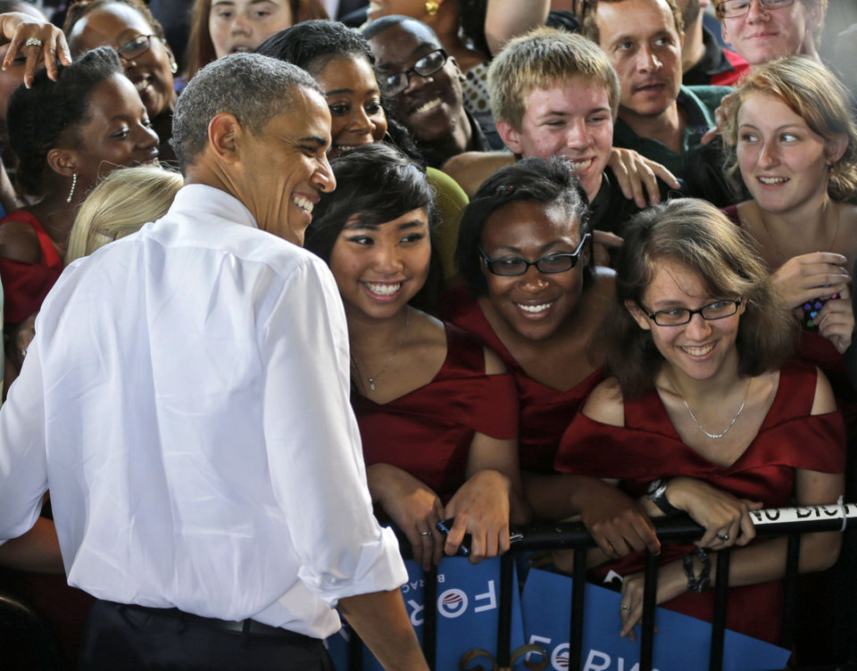 Photo -   FILE - In this Thursday, Sept. 27, 2012 file photo, President Barack Obama stops for a photo with members of the Vox Harmonia Visual and Performing Arts Academy Salem High School at a campaign event at Farm Bureau Live in Virginia Beach, Va. Obama and Mitt Romney are dueling over the size of government and defense cuts, pouring tens of millions of dollars into this crucial battleground, a state where military spending adds enormous sums to the local economy. The winner will claim Virginiaís 13 critical electoral votes - and most likely, better odds for capturing the White House. (AP Photo/Pablo Martinez Monsivais)