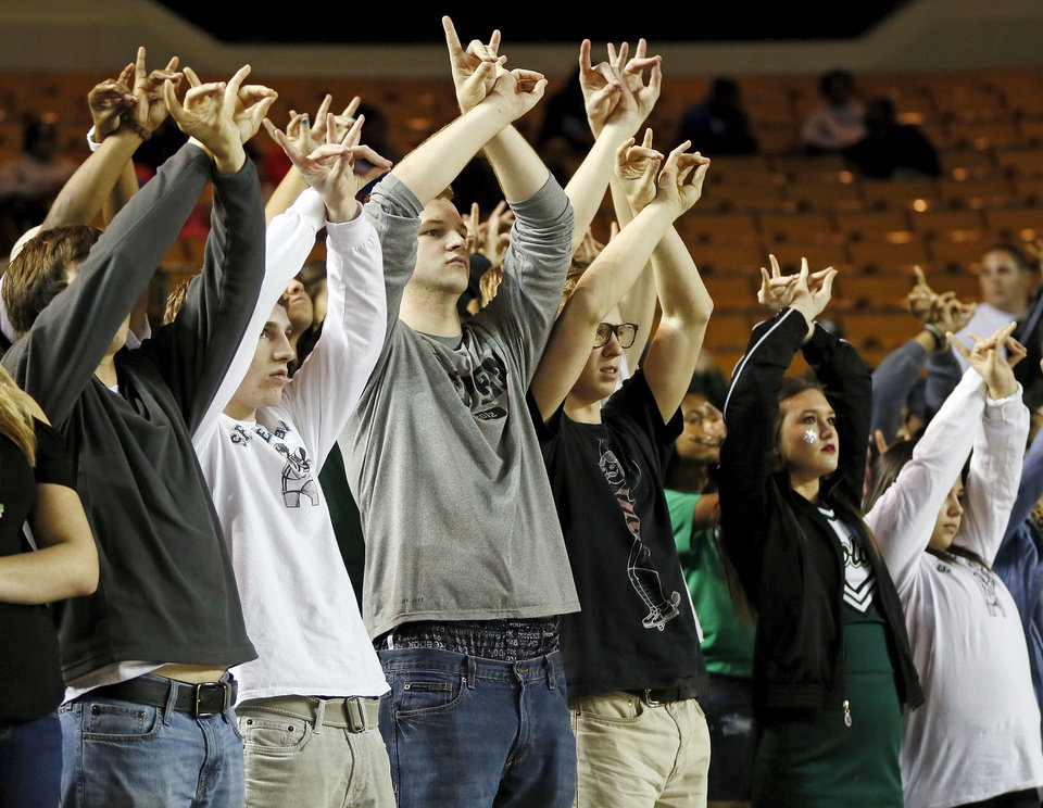 Photo - Edmond Santa Fe fans raise their hands above their heads as one of the Wolves takes a foul shot during a Class 6A girls high school basketball game in the semifinals of the state tournament at the Mabee Center in Tulsa, Okla., Friday, March 8, 2013. Bookter T. Washington won, 72-70. Photo by Nate Billings, The Oklahoman
