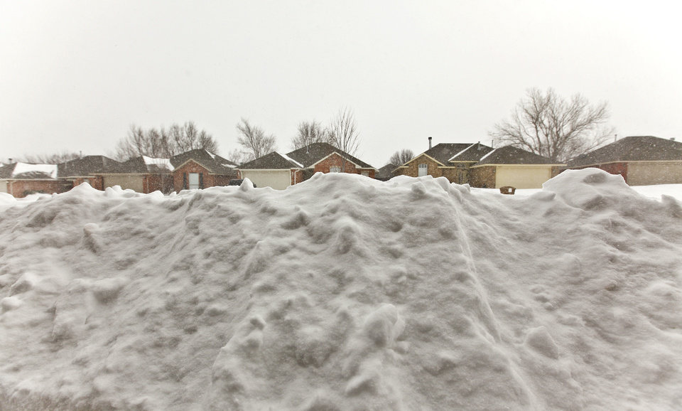 Snow piles up in front of houses on Tuesday, Feb. 1, 2011, in Yukon, Okla.   Photo by Chris Landsberger, The Oklahoman