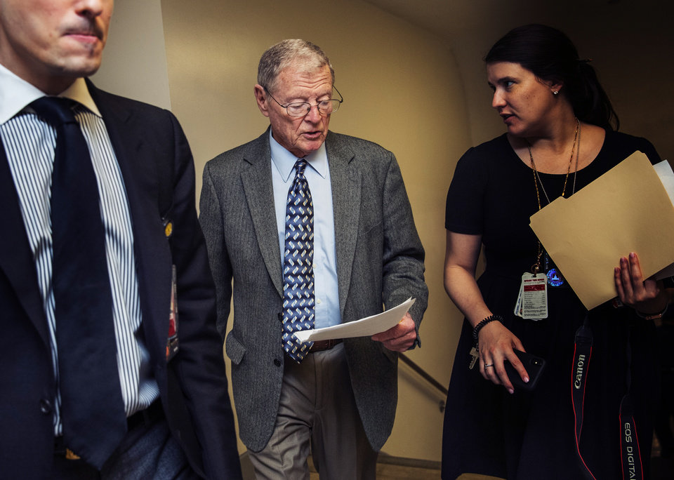 Photo - Sen. Jim Inhofe, R-Okla., walks with his staff on Capitol Hill in Washington, Saturday, Jan. 25, 2020, during the impeachment trial of President Donald Trump on charges of abuse of power and obstruction of Congress. (AP Photo/Manuel Balce Ceneta)