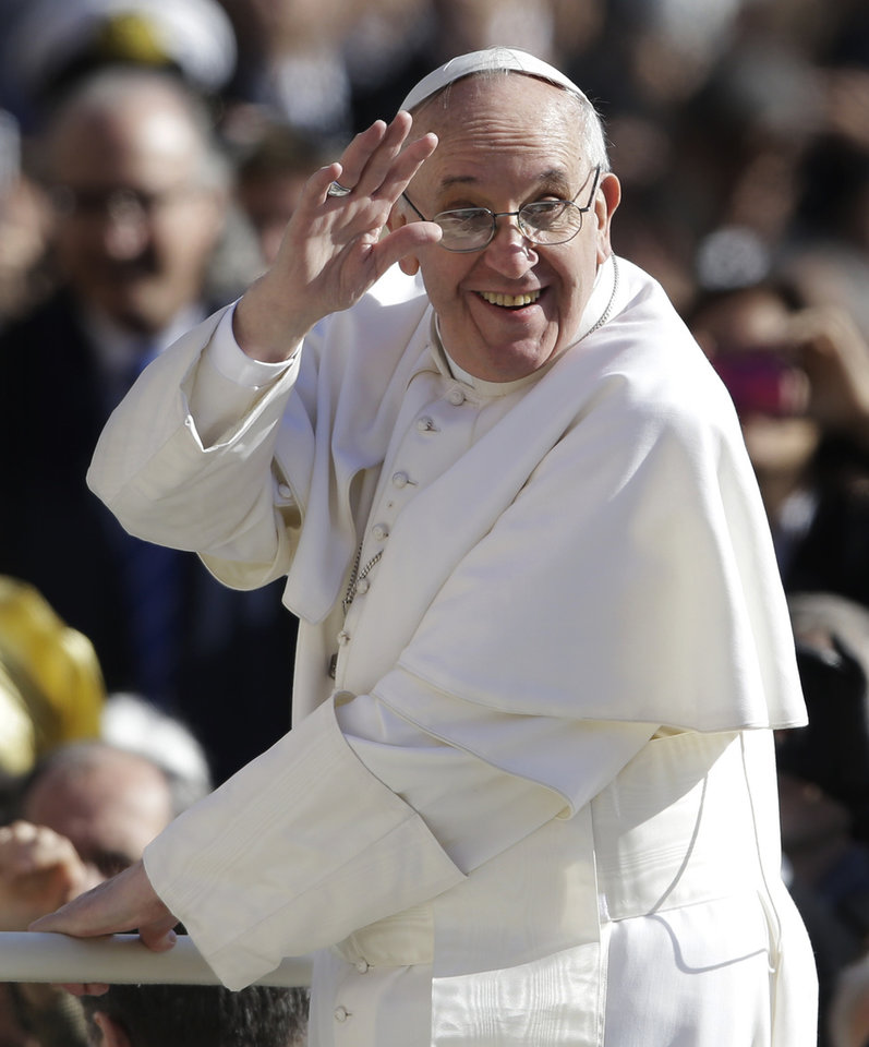 Pope Francis waves to crowds as he arrives to his inauguration Mass in St. Peter\'s Square at the Vatican, Tuesday, March 19, 2013. (AP Photo/Gregorio Borgia)